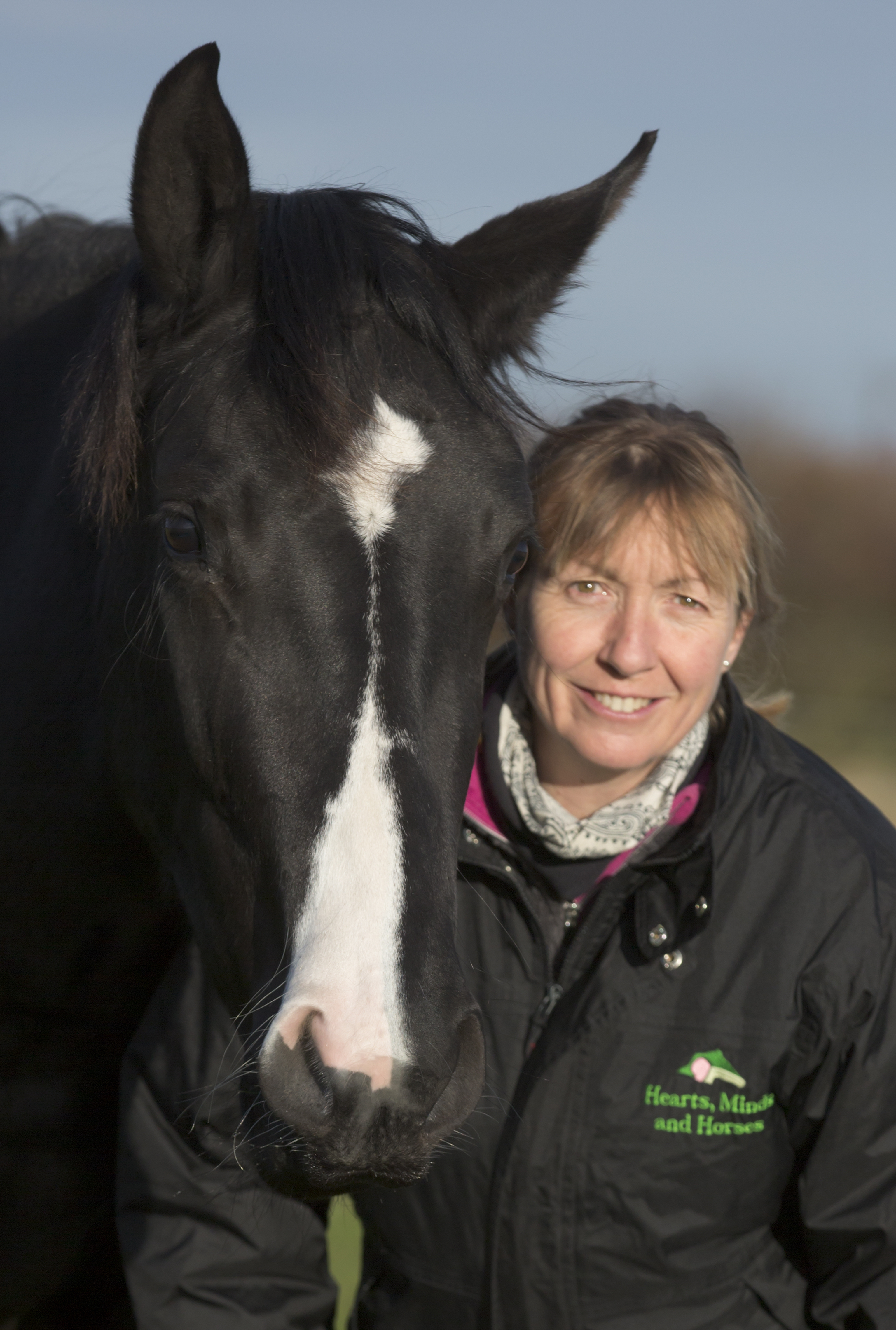 Counsellor, therapist and facilitator, Michelle, with horse
